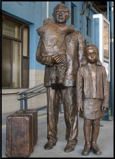 There is a statue of Sir Nicholas and two Kindertransport children on Platform 1 at the main railway station, Prague (Praha hlavní nádraží) created by sculptor Flor Kent.